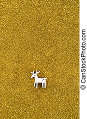 Wooden reindeer Christmas decoration on golden glitter background