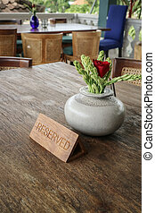 Wooden reserved sign on a  table