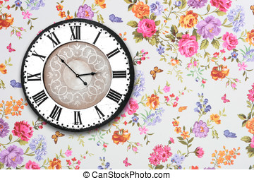 wooden retro clock on floral wallpaper