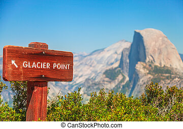 wooden road sign of Glacier Point