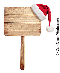wooden road sign with red Santa's hat hanging isolated on white
