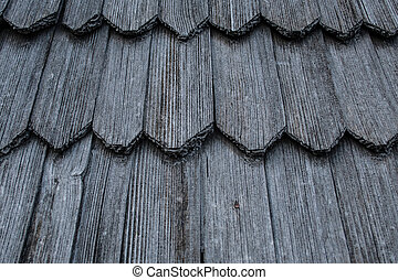 Wooden roof shingles. Texture and background