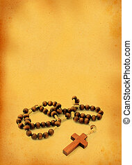 wooden rosary against retro background
