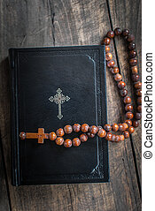 Wooden rosary beads and holy bible