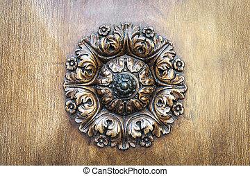 Wooden rosette on door