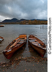 Wooden rowing boats on a lake - Wooden rowing boats moored...