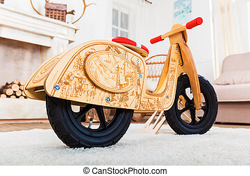 Wooden runbike in the living room at home