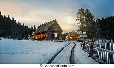 Wooden rural house in winter forest