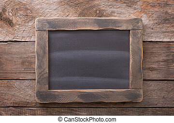 Wooden rustic background with a chalkboard