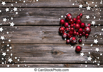 Wooden rustic christmas background with red balls and as frame.