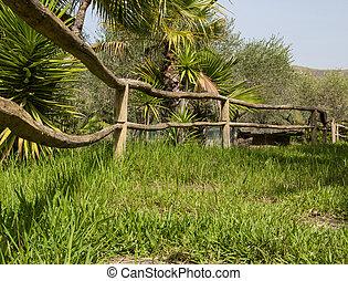 wooden rustic fence in garden  - wooden rustic fence