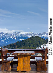 Wooden rustic furniture over mountain landscape