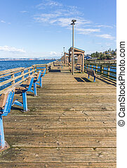 A view of a wooden pier in Ruston, Washington.