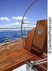 wooden sailboat boat deck blue sky ocean sea