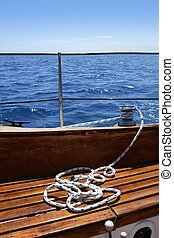 wooden sailboat boat deck blue sky ocean sea