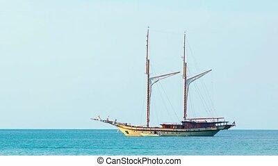Wooden sailboat under bare poles - gaff topsail schooner. UltraHD 2160p 4k video