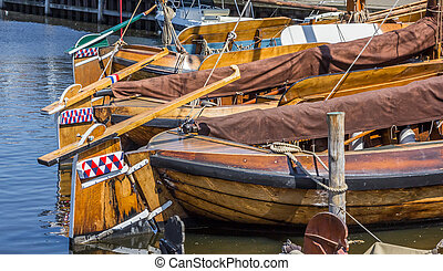 Wooden sailing ships in the harbor of Elburg
