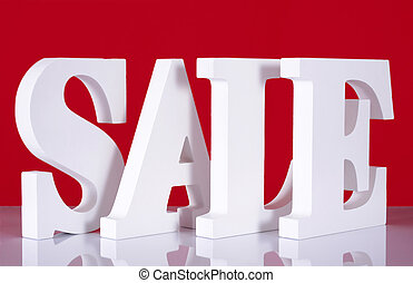 Wooden Sale Letters on Red Background.