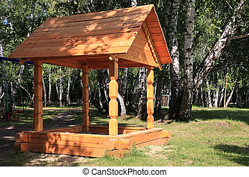 Wooden sand-box in the forest
