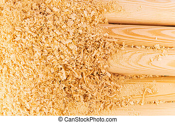 Wooden sawdust and logs - Macro view of wooden sawdust and ...