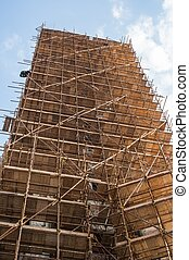 Wooden scaffolding around old building