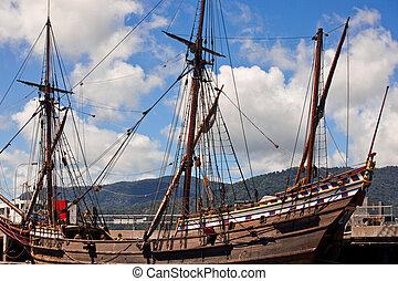 Wooden schooner - Three masted wooden schooner docked at a...