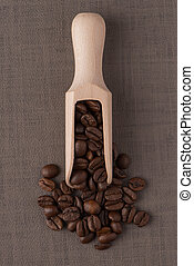 Wooden scoop with coffee beans