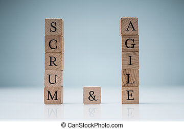 Wooden Scrum And Agile Blocks On Blue Background