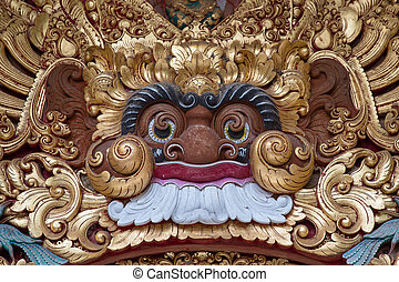 Wooden sculpture of the demon in the temple in Ubud, Bali, Indonesia
