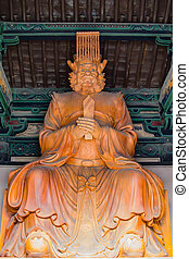 Wooden sculptured Buddhist Diety