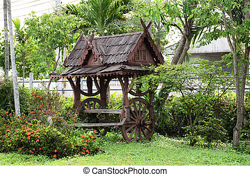 wooden seat or cart in the garden.