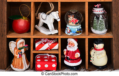 wooden shadow box with christmas decor and toy collection