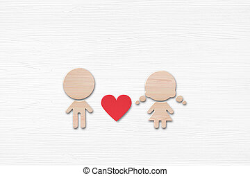 Wooden shape of women and men with red heart on white wood background.