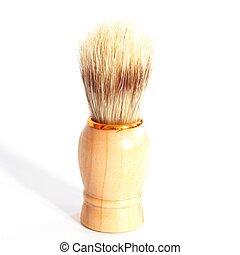 wooden shaving brush isolated on whit background