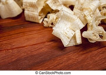 wooden shaving on pine wood background, woodwork carpentry