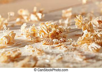 Wooden shavings on the workbench in natural light