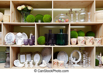 wooden shelf with vases, bottles and photo frames