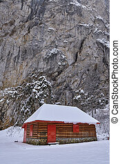 Wooden shelter in the snow