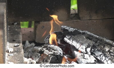 Wooden shelves burn in street mangal on the territory of the...