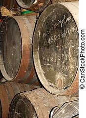 Wooden sherry casks in a bodega between Rota and Jerez de la Frontera, Cadiz Province, Andalusia, Spain, Western Europe.