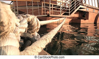 wooden ship moored rope
