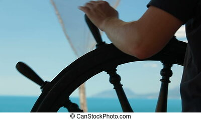 The navigator at the helm of the vessel