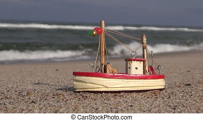 Wooden ship toy by the sea