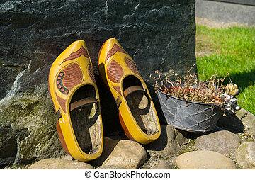 Wooden shoes on Dutch grave