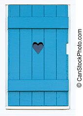 Wooden shutter with a carved heart