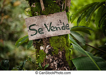 Wooden sign announcing real estate for sale in Costa Rica