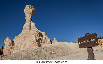 Wooden sign at the Queens Garden trail in  Bryce Canyon