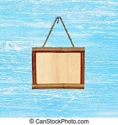 Wooden sign board blank frame on old blue wood background