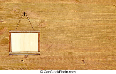 Wooden sign board blank frame on wood background