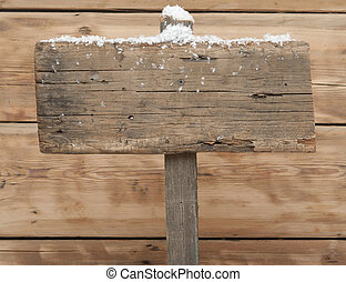 Wooden sign in winter with copyspace